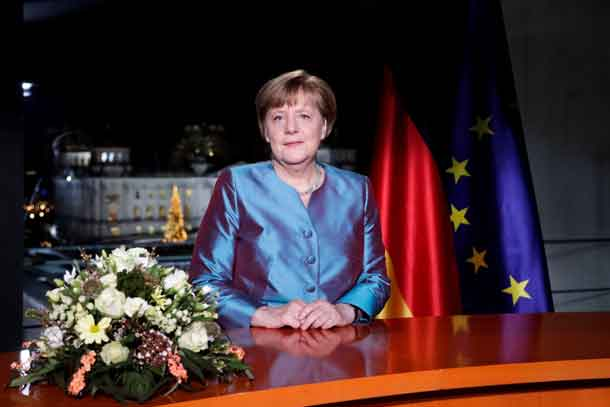German Chancellor Angela Merkel poses for photographs after the television recording of her annual New Year's speech at the Chancellery in Berlin, Germany, December 30, 2016. REUTERS/Markus Schreiber/Pool