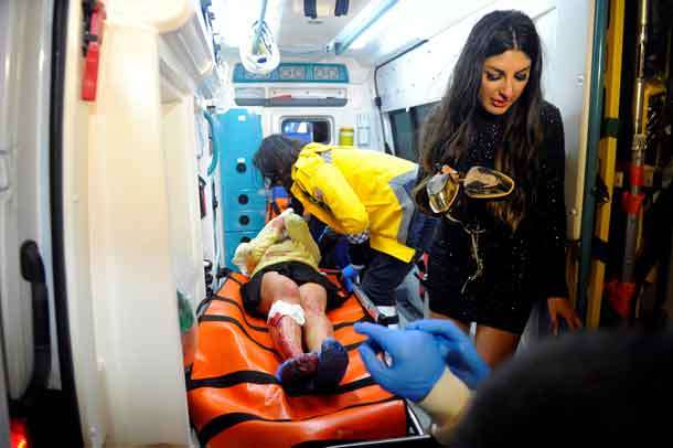 An injured woman is carried to an ambulance from a nightclub where a gun attack took place during a New Year party in Istanbul, Turkey, January 1, 2017. Murat Ergin/Ihlas News Agency via REUTERS