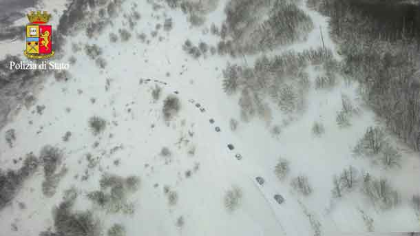 An aerial photo shows the rescuers heading to Hotel Rigopiano in Farindola, central Italy, hit by an avalanche, in this January 19, 2017 handout picture provided by Italian Police. Polizia Di Stato/Handout via REUTERS