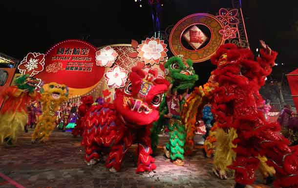 "Lion dancers perform during the Cathay Pacific International Chinese New Year Night Parade, Hong Kong, China, January 28, 2017. Themed ""Best Fortune. World Party"", the 2017 Cathay Pacific International Chinese New Year Night Parade was held on the first day of Chinese New Year and featured the largest number of performers in the event's history. Mandatory Credit: Hong Kong Tourism Board via REUTERS"