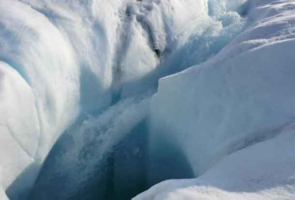 Meltwater from the Greenland ice sheet can travel through channels in the ice to reach bedrock; a new study show where subglacial water goes. Here, water plunges down a moulin, or hole in the ice. CREDIT: Marco Tedesco/Lamont-Doherty Earth Observatory