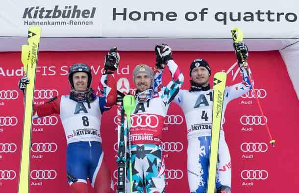 KITZBUEHEL,AUSTRIA,22.JAN.17 - ALPINE SKIING - FIS World Cup, Hahnenkamm-race, slalom, men, award ceremony. Image shows the rejoicing of Dave Ryding (GBR), Marcel Hirscher (AUT) and  Alexander Khoroshilov (RUS). Photo: GEPA pictures/ Andreas Pranter //