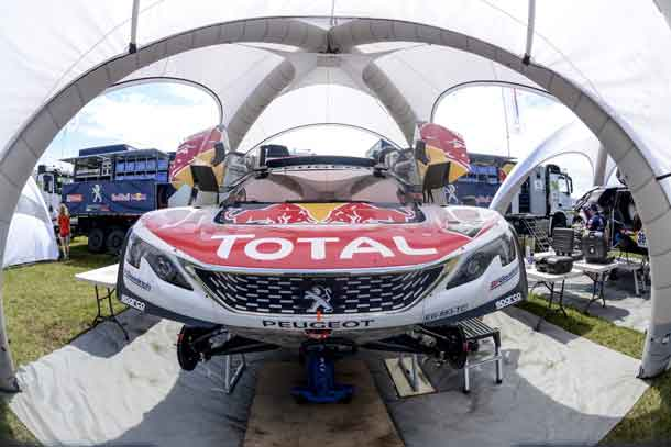 A Team Peugeot TOTAL race car being prepared in the service area for the Dakar Rally 2017 in Asuncion, Paraguay on december 31, 2016 // Marc Bow/Red Bull Content Pool // P-20161231-00136 // Usage for editorial use only // Please go to www.redbullcontentpool.com for further information. //