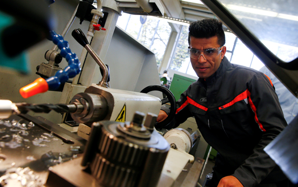 FILE PHOTO - Qudratullah Hotak, a 23-year-old refugee from Afghanistan  works with a driller at the training workshop of Ford Motor Co in Cologne, Germany, November 3, 2016.  REUTERS/Wolfgang Rattay/File Photo