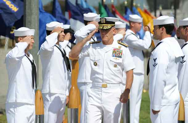 Vice Admiral Robert S. Harward, commander of Combined Joint Task Force  435, salutes during a SEAL Team 5 change of command ceremony in San Diego, California July 11, 2011. Picture taken July 11, 2011.  Photo courtesy of Petty Officer 2nd Class Marc Rockwell-Pate/U.S. Navy/Handout via REUTERS