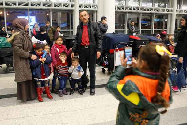 Members of a Syrian refugee family pose for a picture at Beirut international airport ahead of their travel to the United States, Lebanon February 8, 2017. REUTERS/Mohamed Azakir