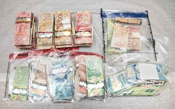 Part of the cash seized by OPP and Ottawa Police in a drug raid