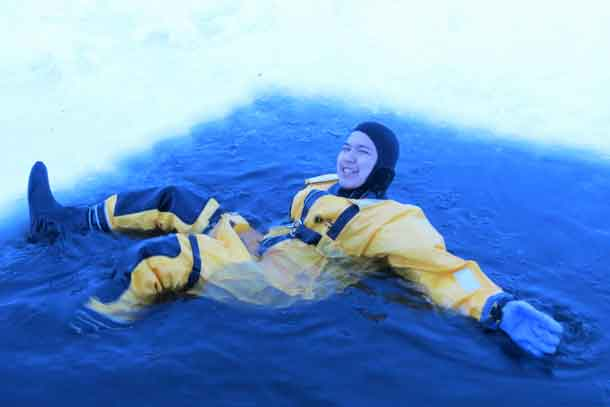Ranger Harry McKay of Sachigo Lake wears an immersion suit during ice rescue training.