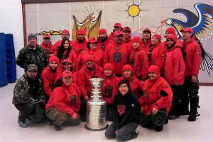Canadian Rangers pose with the Stanley Cup in Sandy Lake First Nation.