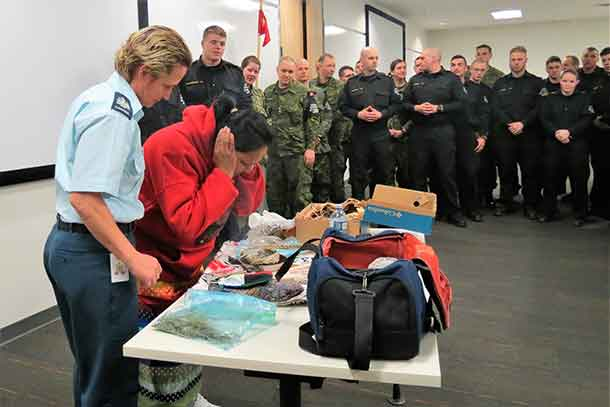 Master Corporal Florrie Sutherland, a member of the Constance Lake First Nation Canadian Ranger patrol, smudges during a talk at the Canadian Forces Military Police Academy.
