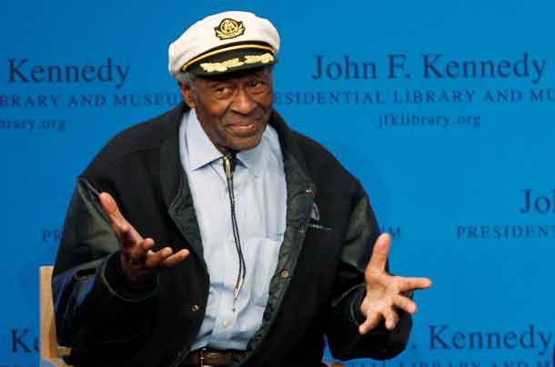 Chuck Berry gestures to the audience at the 2012 Awards for Song Lyrics of Literary Excellence awarded to both he and Leonard Cohen at the John F. Kennedy Presidential Library and Museum in Boston, Massachusetts February 26, 2012. REUTERS/Jessica Rinaldi/File Photo