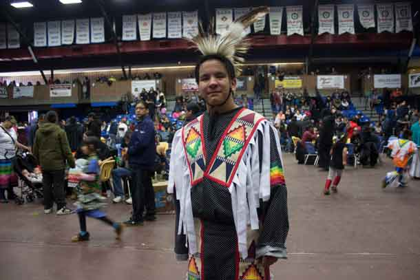 Munzeroy celebrates at the LUNSA Pow Wow. This young man has been following the Pow Wow trail for many years.