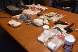 Thunder Bay Police image showing cash, replica firearm, drugs and other items seized