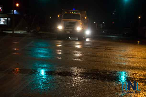 Thunder Bay Road Crews were out Tuesday night putting down a layer of ice melting material