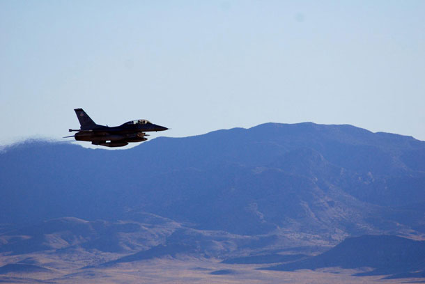 An F-16C makes a pass over Nevada's Tonopah Test Range after a March test of a mock nuclear weapon as part of a Sandia National Laboratories life extension program for the B61-12. Teams will spend months analyzing the data gathered from the test. CREDIT: Sandia National Laboratories/Photo by James Galli