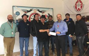 Perimeter Executives presenting $50K cheque to Chief Bart Meekis and Council. L. to R. Perimeter Cargo Operations Manager Andrew Fast, Deputy Chief Robert Kakegamic, Councillor Allen Rae, Chief Bart Meekis, Councillor Dennis Kakegamic, Perimeter Vice-President Commercial Services Carlos Castillo, Councillor John McKay and Councillor Russell Kakepetum