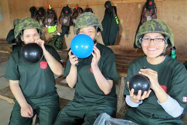 Junior Canadian Rangers blowing balloons up for target practice are, from left, Alyssa McKinney and Brianna Miles, both from Fort Severn, and Brianna Goodman from Sandy Lake.