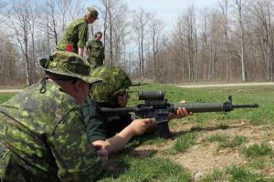 Junior Canadian Ranger Claudia Albany shoots with the army's C7 assault rifle.