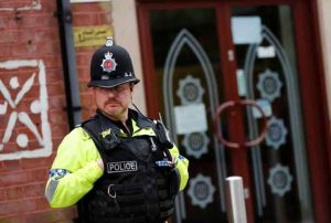 A police officer stands outside Didsbury mosque in Manchester, Britain May 24, 2017. REUTERS/Stefan Wermuth