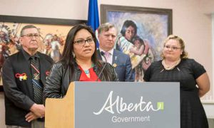 L-R: Don Langford, executive director, Metis Child and Family Services Society; Janice Randhile, Family Information Liaison Unit staff member, liaison for southern Alberta; Richard Feehan, Minister of Indigenous Relations; and Sarah Hoffman, Minister of Health and MLA Edmonton-Glenora.
