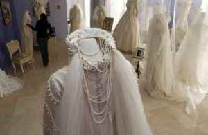 A visitor looks at wedding dresses during an exhibition at the Cultural center building in Ciudad Juarez in this 2012 archive photo. REUTERS/Jose Luis Gonzalez