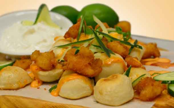 Chili Lime Popcorn Shrimp Perogies We're landing in Thailand this year to enjoy the fresh summer flavours of Chili and Lime with the new Chili Lime Popcorn Shrimp Perogies. These mini perogies are topped with crispy panko crusted shrimp drizzled with sweet chili glaze and a spicy siracha mayo! All finished with crisp cucumbers and a mist of lime juice topped on a fluffy perogy