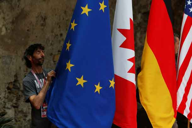 Flags are placed at the G7 summit in Taormina, Italy, May 26, 2017. REUTERS/Darrin Zammit-Lupi