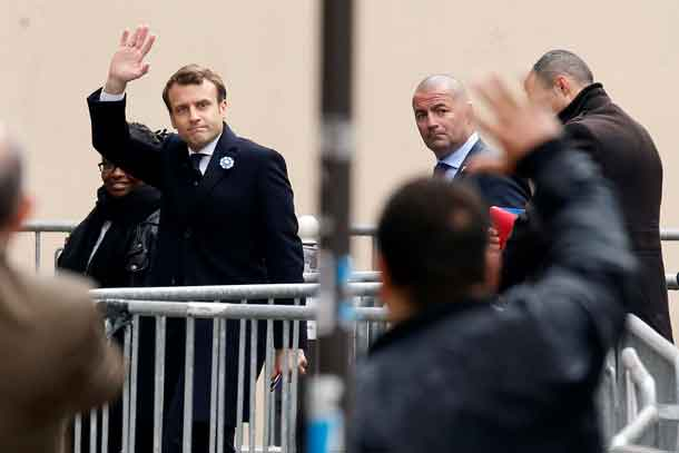 French President elect Emmanuel Macron waves as he arrives at his campaign headquarters in Paris, France, May 8, 2017. REUTERS/Gonzalo Fuentes