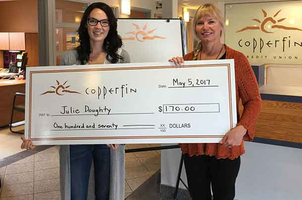 Julie Doughty receives her dividend cheque at the Copperfin Syndicate Branch