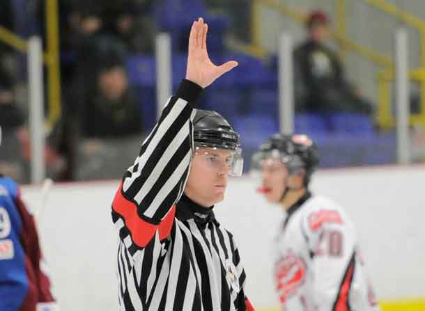 "FORT FRANCES, ON - Apr 30, 2015 : Central Canadian Junior ""A"" Championship, game action between Dryden GM Ice Dogs and Fort Frances Lakers, game six of the Dudley Hewitt Cup, OHA Referee (Photo by Amy Deroche/ OJHL Images)"