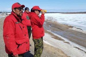 Canadian Rangers monitoring the ice and water levels on the Albany River at Kashechewan are Master Corporal Robert Wynne, of Kashechewan, and Rangers Leonard Beaver and Jessie Wabasse, both from Webequie. Credit ergeant Richard Mifflin, Canadian Army