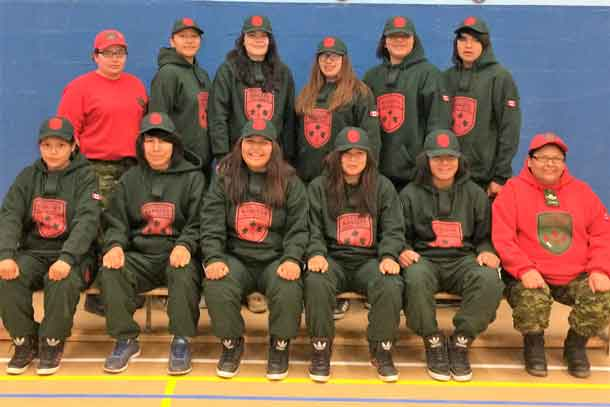 The 10 members of the Junior Canadian Ranger team representing Northern Ontario with their Canadian Ranger escorts.