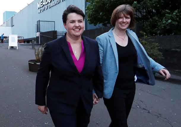 Ruth Davidson, leader of the Scottish Conservatives, leaves the counting centre for Britain's general election with her partner Jen Wilson in Edinburgh, Scotland, June 9, 2017. REUTERS/Russell Cheyne