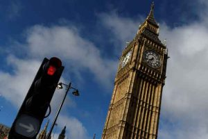 A red traffic light is seen next to Big Ben, in Westminster, central London, Britain, June 9, 2017. REUTERS/Clodagh Kilcoyne