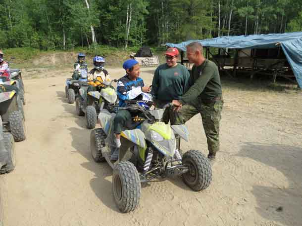 unior Canadian Ranger Chad Bottle takes last minute instructions from Master Corporal Sherrie Kakekespan and Sergeant Kevin Meikle before beginning a challenging cross country ATV ride. credit Sergeant Peter Moon, Canadian Rangers