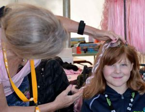 Camper Nevaya getting a pink highlight in her hair!