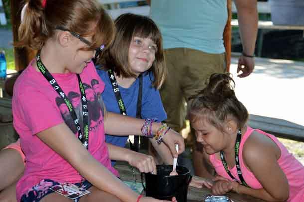 Campers Nevaya (left), Kassi and Sam preparing their magical potion.