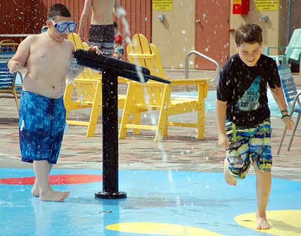 Camper Ali (left) getting ready to spray camper Gryphon in the splash pad at KOA!