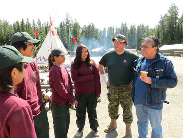 Chief Brennan Sainnawap of Wapekeke First Nation, right, talks with Junior Canadian Rangers during a visit to Camp Loon, a Junior Ranger training camp.  credit: Sergeant Peter Moon, Canadian Rangers
