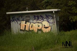 Graffiti on a building at McVicars Creek near where police found Kevin Roundhead
