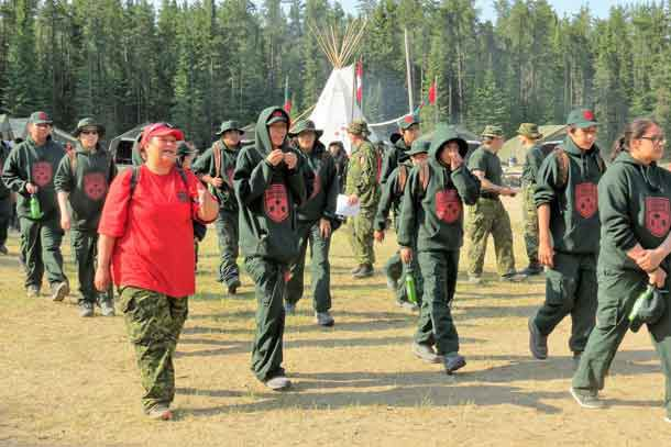 A Canadian Rangers leads Junior Canadian Rangers to a training site at last year's Camp Loon.