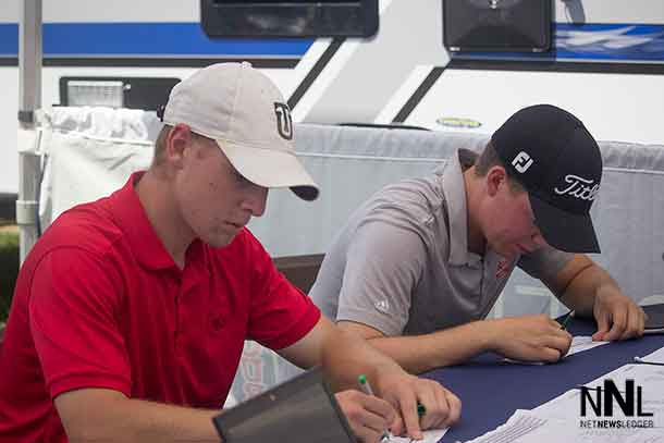 Local Thunder Bay Players Dustin Barr and Evan Degrazi at the scoring tent after their second round at the Staal Foundation Open