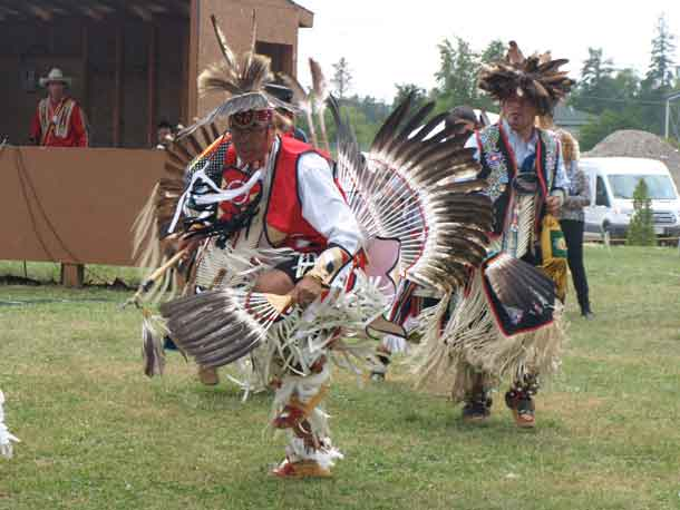 photo by Xavier Kataquapit  MALE DANCERS IN TRADITIONAL REGALIA performed at the 7th Annual Mattagami FN Pow Wow. Pictured left is Charlie Kioke, of Attawapiskat First Nation and on the right is Ontario Regional Chief Isadore Day, Chiefs Of Ontario.