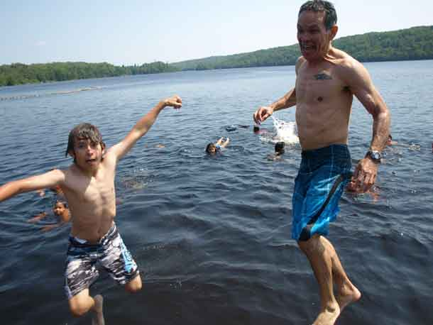Shawn Batise, Ontario Provincial Assistant Deputy Minister for the Negotiations and Reconciliation Division of the Ministry of Indigenous Relations and Reconciliation attended the Wabun Youth Gathering junior event recently. Here we see Batise and his son Quinton jumping into Horwood Lake.
