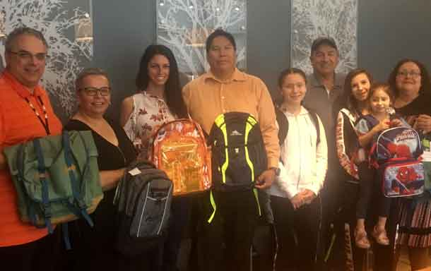 Pictured (left to right): Jeffrey Busniuk-Director of Finance-FWFN, Karen Bannon-Director of Health & Community Services-FWFN, Brittany Collins-Education Assistant-FWFN, Aaron Kakepetum-Senior Account Manager, First Nation Banking-RBC, Daanis Pelletier-student from FWFN, Peter Collins-Chief of FWFN, Tashina Szyja & Saydee Rae Waller-parent & student from FWFN, Myra Bannon-Education Manager-FWFN.
