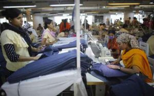 Employees work in a factory of Babylon Garments in Dhaka, Bangladesh, in this January 3, 2014, archive photo. REUTERS/Andrew Biraj