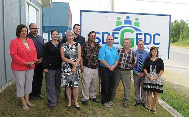 """Minister Hajdu is joined by Greenstone municipal councillors, along with staff, directors and a client of the Greenstone EDC: Michel """"Mike"""" Leclair of Silver Lining Cabinetry Ltd. who has hired seven local people in the last year due to increasing demand."""