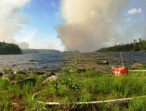 An Incident Management Team is in place to manage the fire and limit its spread toward the community of Nibinamik to the south.