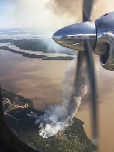Red Lake District Fire Number 066, started on August 10 and challenged firefighting resources. FireRangers have circled the fire with hose line but it is still listed as not under control at 10 hectares. Constant air attack from Ontario, with assistance from Manitoba, and helicopter bucketing helped stop the fire from advancing to homes and fuel tanks.