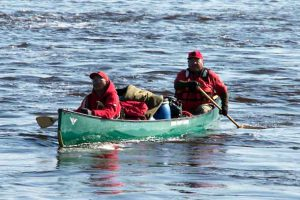 Two Canadian Rangers paddle their heavily laden canoe during the river patrol. credit: Master Corporal Kurt Rickard, Canadian Rangers